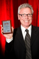 Associate Professor Mark Carroll with his Adelaide Research & Innovation !mpact Award. Photo by Jennie Groom.