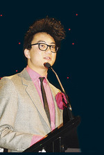 Flute player Anouvong Liensavanh received his $5000 prize at the Adelaide Convention Centre