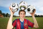 Physics Masters student Adrian Kiratidis with three different soccer balls – the Teamgeist, the <i>Jabulani</i> and a regular soccer ball Photo by Matt Carty, courtesy of <i>The Advertiser</i>