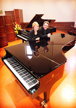Associate Professor Carl Crossin, Director of the Elder Conservatorium of Music, and Lucinda Collins, Head of Keyboard, with the two brand new Steinway pianos Photo by Mark Brake, courtesy of <i>The Advertiser</i>