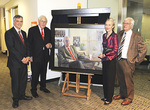 From left: Professor John Beltrame, Dr Basil Hetzel AC, artist Avril Thomas and Professor Dick Ruffin flank the portrait, which now hangs in the Basil Hetzel Institute for Medical Research at the Queen Elizabeth Hospital