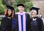 Sophie Karanicolas (left) and Catherine Snelling (right) photographed with the Dean of the School of Dentistry, Professor Johann de Vries.
