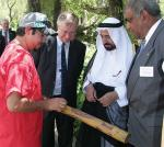 His Highness the Ruler of Sharjah (second from right) learns the finer points of didgeridoo playing from CASM student Matthew Johnson (left), with Pro Vice-Chancellor (International) Professor John Taplin (second from left), and Centre for Australian Indigenous Research & Studies Director Professor Roger Thomas Photo by Ben Osborne