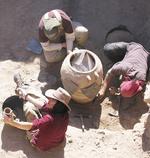 Adelaide students excavating an 8th century water jar at Khirbet es-Sheikh Isa, Jordan Photo courtesy of Dr Margaret O'Hea