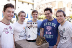 Engineering students (from left) Greg MacFarlane, Matthew Read, Matthew Higgins, Tomas West and Josh Wilkey demonstrate their prototype cooking stove (made out of recycled materials) and samples of dung that can be burnt inside it