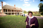 Manager Lynette Zeitz in period costume outside Urrbrae House
