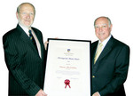 Professor James McWha (left) presents Maurice de Rohan with his Distinguished Alumni Award in London