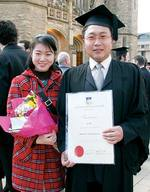 Li Bo graduated with a Bachelor of Economics, pictured with friend Jing Shi