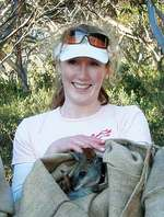 Left: Leah Kemp pictured with a Tammar Wallaby at Innes National Park