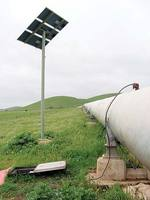 A chlorine monitoring site on the Myponga trunk main at Cactus Canyon. The small copper pipe feeds water to the chlorine monitor in the black box, powered by the solar panel in the background