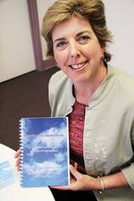 Dr Cate Howell with her book, <i>Keeping the Blues Away</i>