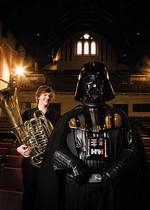 From left: University of Adelaide music student Stevan Pavlovic (tuba) with Darth Vader (aka <i>Star Wars</i> fan Matt Tucker)