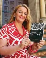Allayne Webster with her first novel Photo by David Ellis