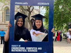 ECMS graduates with flowers