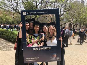 Graduates with corflute