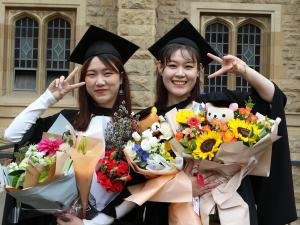 Graduates with flowers