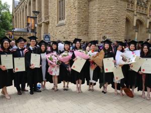Graduates with parchments