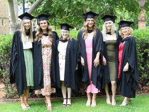 Graduates on lawn