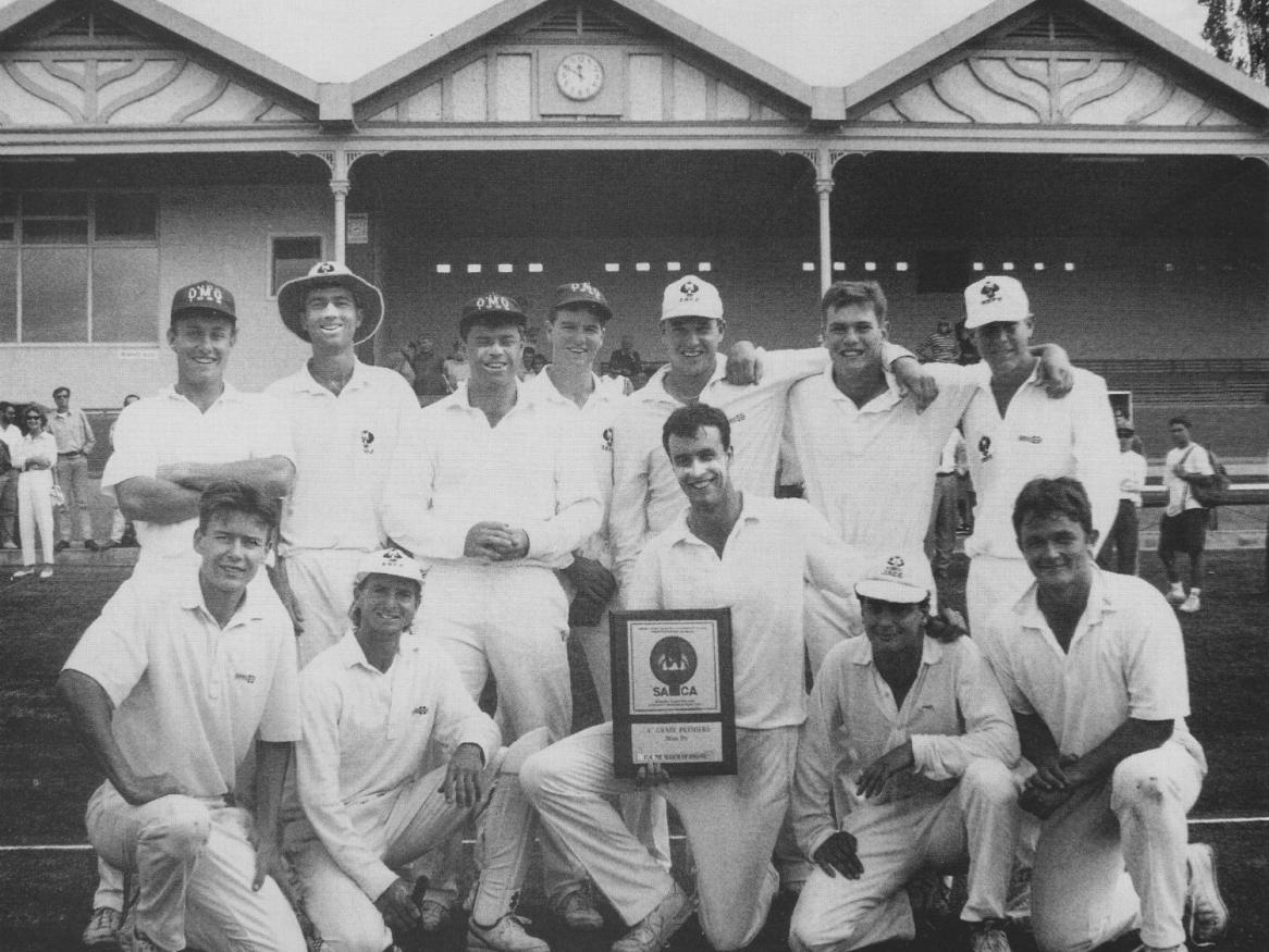 ​​​​​​​Chris Owen (front centre) and the A-grade team he led for a premiership in 1992/93 at the University cricket ground. Photo by Bryan Charlton