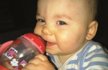 Toddler drinking from Sippy Cup