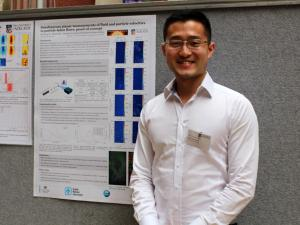 Xiaopeng Bi with his poster
