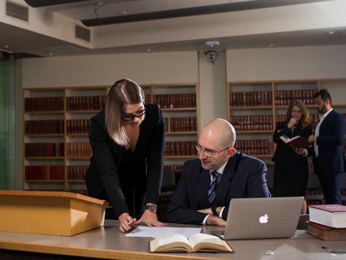lawyers consulting at moot court