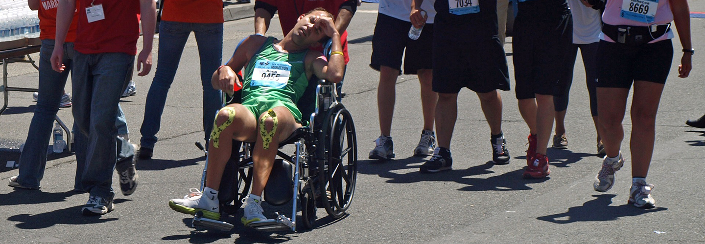 marathon runner finishing in wheelchair - image
