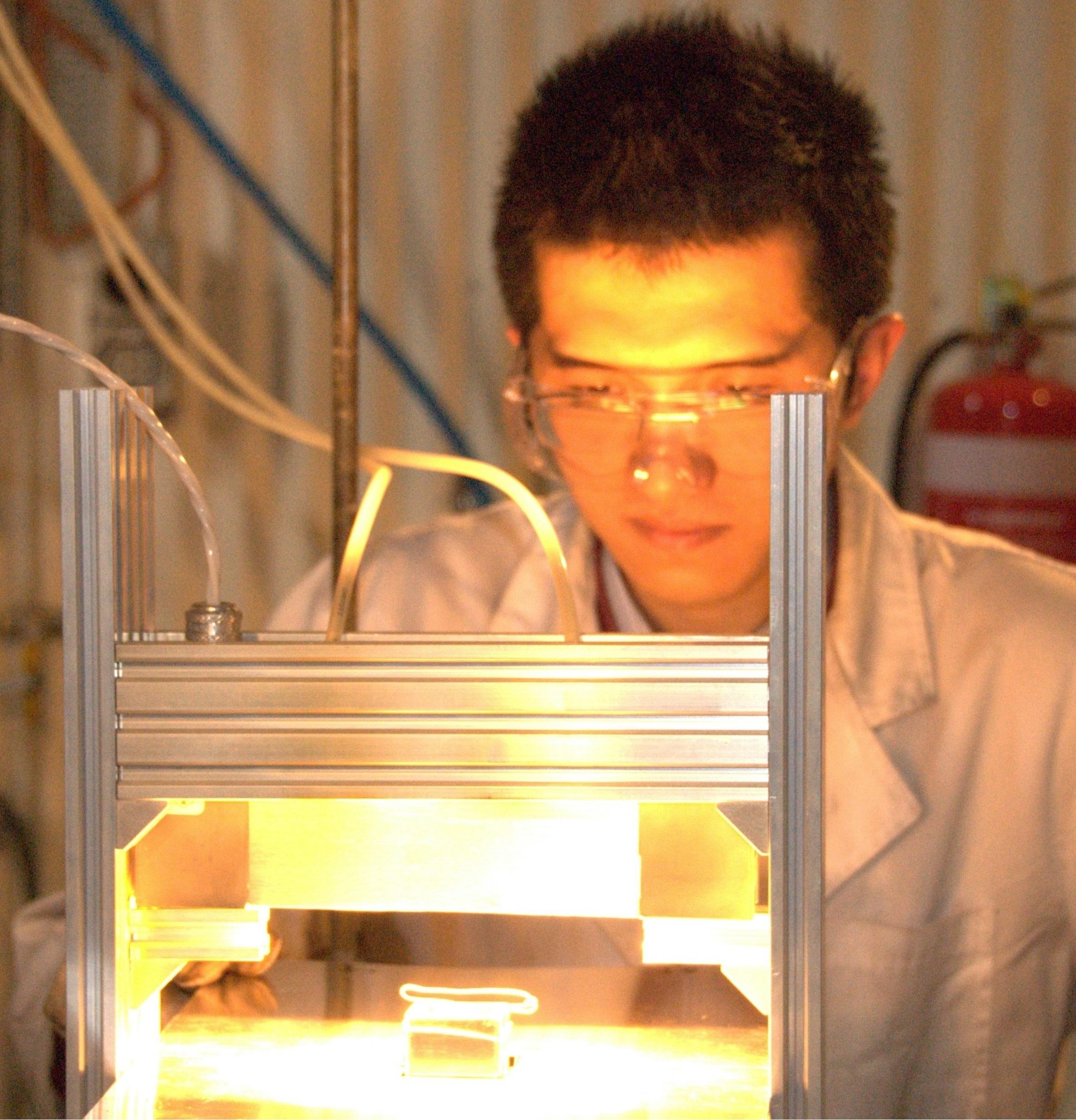 Mr Houzhi Wang