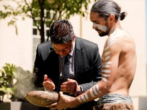 Professor Lester-Irabinna Rigney, Dean Indigenous Education, participating in a traditional Aboriginal Smoking Ceremony (performed by Paitya Dance Group) at the launch of the Tarrkarri Tirrka: Aboriginal and Torres Strait Islander Education Strategy, November 2013.