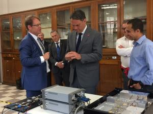 Prof Andre Luiten shows The Hon Richard Marles the sapphire clock