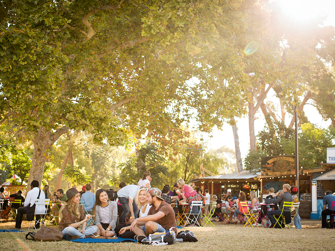 Living in Adelaide - Image at the Fringe Festival, group of people sitting on the grass having fun
