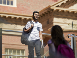 Student walking past the library