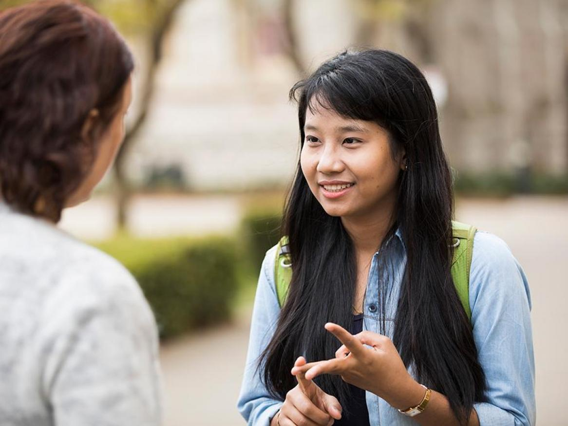 Student talking with another student outside near Bonython Hall