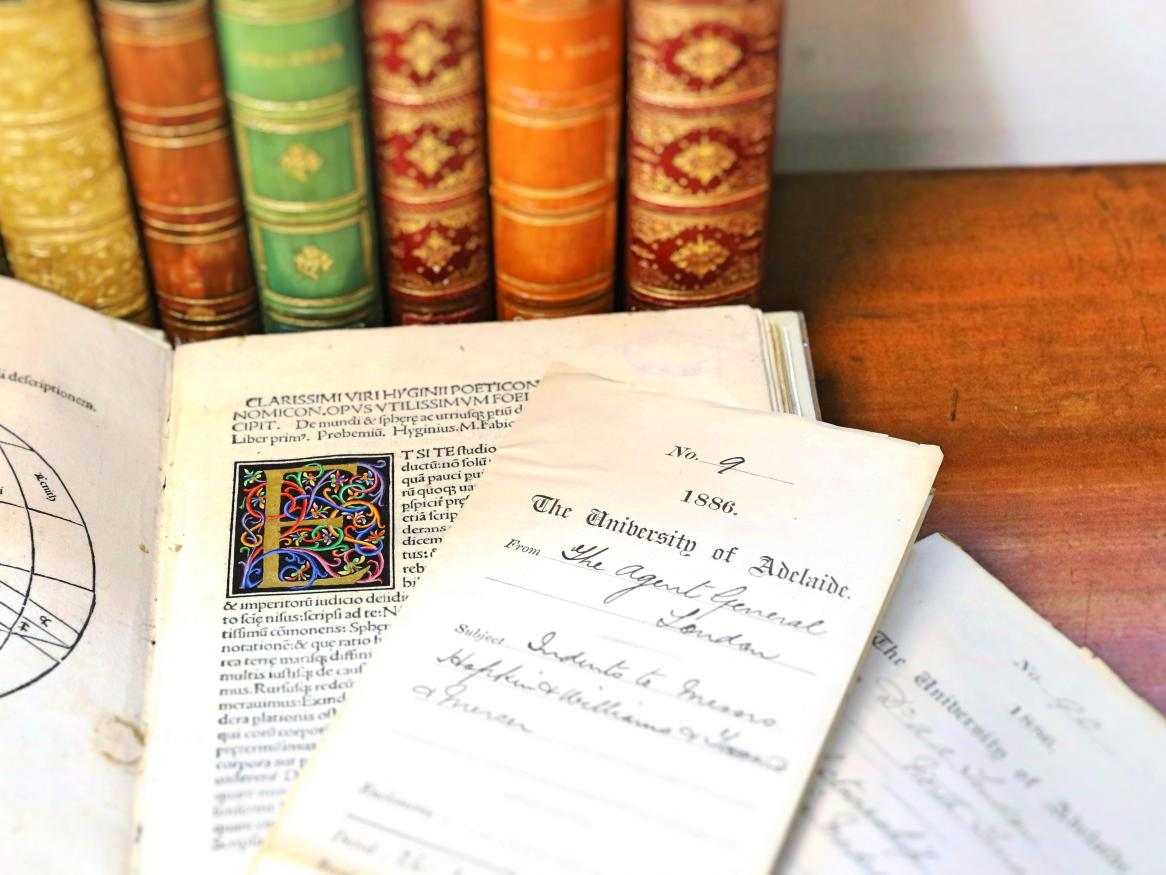 Photo of rare books and a University pamphlet
