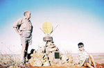 Reg and Douglas at the cairn atop Geosurveys Hill in the Simpson Desert.