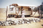 Griselda in the foreground of their temporary home - a caravan.