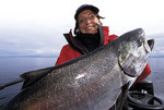 Catch of the day: Anita Stewart holding a Chinook Salmon from the Pacific Ocean off the coast of British Columbia. PHOTO JAMES SMEDLEY