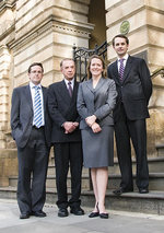 Chief Justice John Doyle flanked by his family (left to right) Sam, Hannah and Ben Doyle.