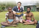 Dr Andrew Perry (Class of 2004) with two patients (brothers) who were treated for shotgun injuries from tribal fighting. The patient on the right required amputation of his gangrenous arm.