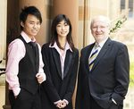 Vice-Chancellor and President Professor James McWha with scholarship recipients: Bachelor of Laws and Bachelor of Commerce (Corporate Finance) student Minh Bui and Bachelor of Laws and Bachelor of Design student Jie Gao.