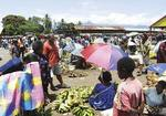 Local food markets in the Solomon Islands, featuring coloured fruits and vegetables.