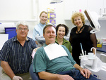 Dr John Reed, dental student Emma Bailey, dental assistant  Sharon Reed, Margie Steffens and patient Michael at the Common Ground Dental Clinic.