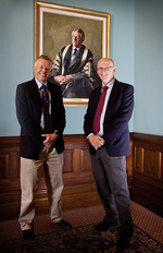 Dr Geoffrey Stranks and Associate Professor Stephen Stranks in front on their father's portrait.