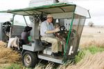 Professor Rathjen harvesting durum wheat in 2010. Picture by Paula Thompson, courtesy of the <i>Stock Journal</i>.