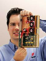Dr Bradley Ferguson with a digital RF (radio frequency) processor, designed and manufactured by Tenix for use in several projects, including a highly sensitive digital radar receiver.