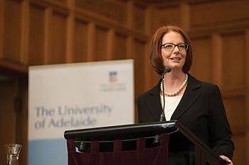 Julia Gillard accepting her 2013 Distinguished Alumni Award