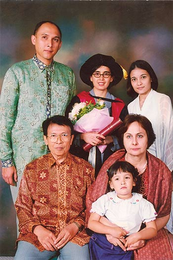 Dr Atmosukarto with family at her PhD graduation