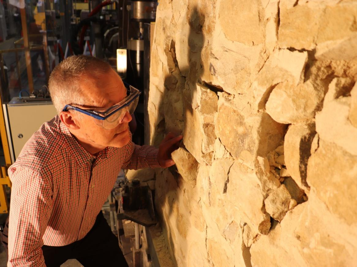 Professor Michael Griffith examining the test wall