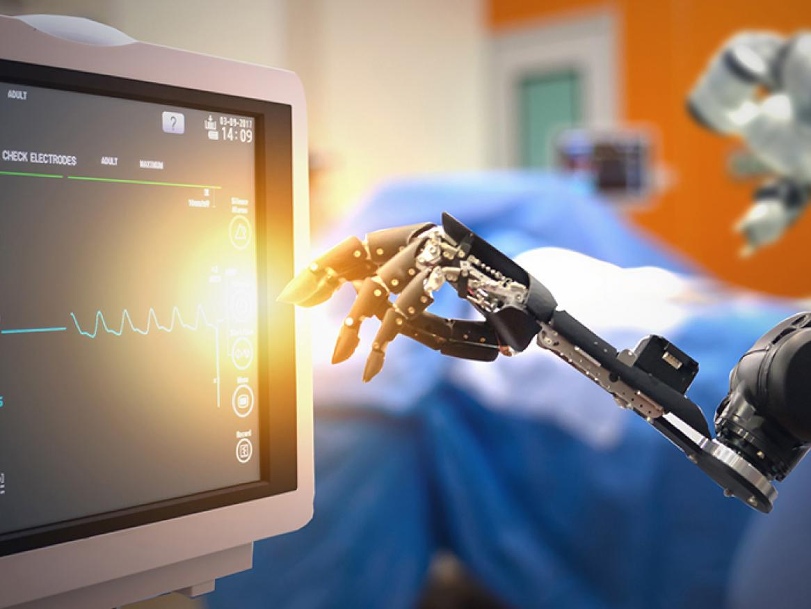 Robots arm reaching for a medical monitoring screen
