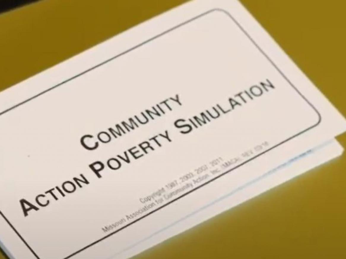 Community Action Poverty Simulation workbook on a table